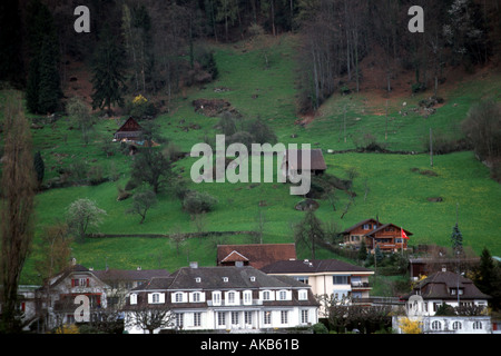 Looking down on the contrasting exterior of this Swiss architecture one can view beautiful green landscape and many - Stock Photo