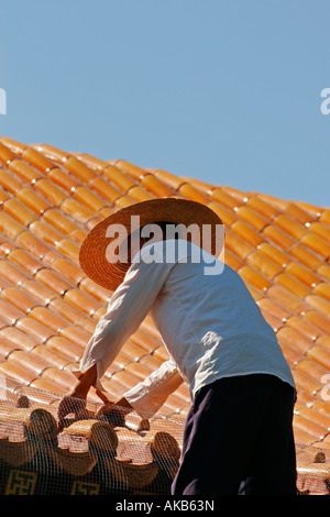 Asian workers repairing Buddhist Temple - Stock Photo