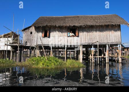 Myanmar (Burma), Shan State, Inle Lake, house on stilts in floating village - Stock Photo