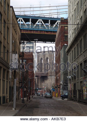 The Brooklyn Bridge seen from a rural street in Brooklyn with the Manhattan Bridge in the foreground - Stock Photo