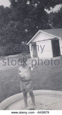 A young boy showing his little boat - Stock Photo