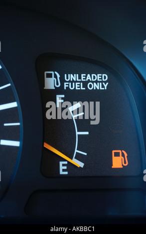 Fuel gauge on empty - Stock Photo