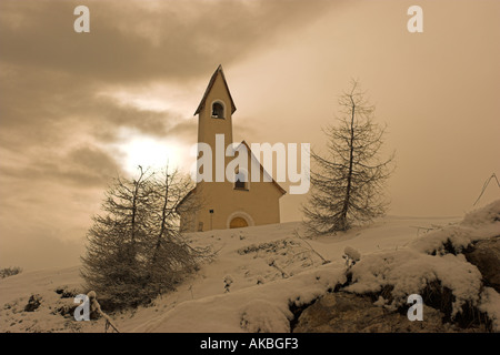 Tiny chapel at the top of the Passo Gardena pass at 2121m high in the Alta Badia region of the Dolomite mountains - Stock Photo