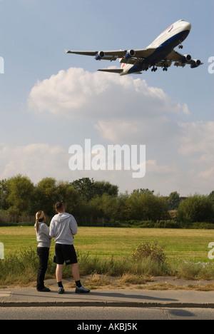 British Airways airplane approaches Heathrow Airport London - Stock Photo