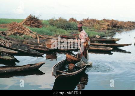 Pole boats on coast of Benin West Africa - Stock Photo