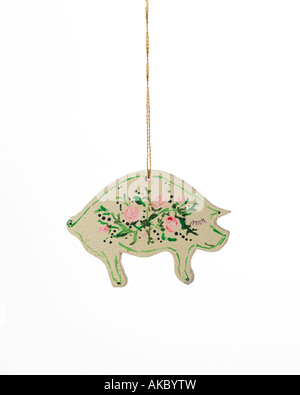 vintage Christmas ornament  decoration of pig with hand-painted flowers on its back and hanging from gold thread - Stock Photo