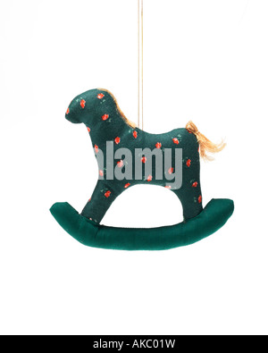 Christmas ornament rocking horse hanging on hook - Stock Photo