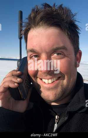 Qaanaaq Greenland Graham Dickson Using iridium satellite phone in the high Arctic - Stock Photo
