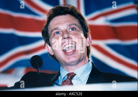 Prime minister Tony Blair against a Union Jack in 1996 soon after becoming leader of the labour party - Stock Photo