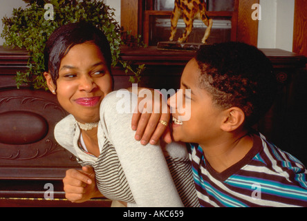 African American brother and sister happy together ages 12 and 15. St Paul Minnesota USA - Stock Photo
