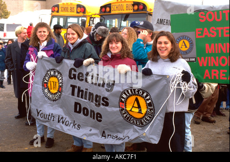 Americorps Volunteers age 18 celebrating at  Martin Luther King Day Parade. St Paul Minnesota USA - Stock Photo