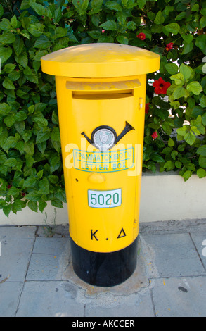 Yellow letter box on the Mediterranean island of Cyprus EU - Stock Photo