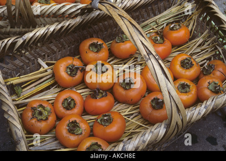 Persimmon fruits for sale Kaili Market China - Stock Photo