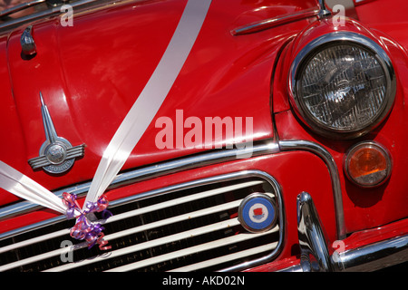 a red mini used for a wedding - Stock Photo