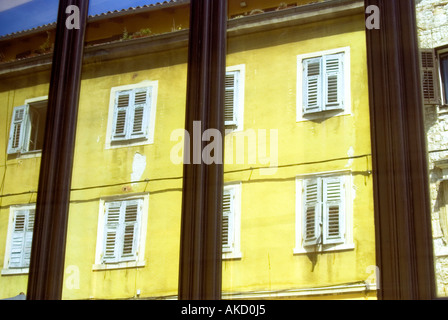 Croatia, Istria, Pula, tenement house seen through window - Stock Photo