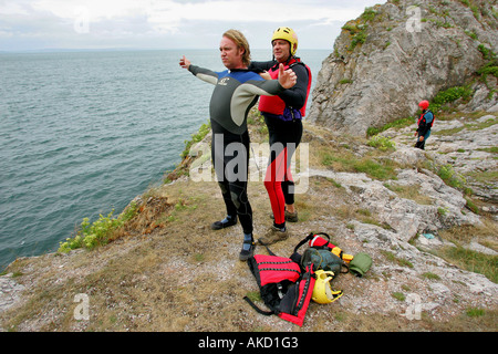 Preparing for coasteering in Torbay Devon England UK - Stock Photo