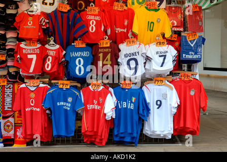 market stall with football shirts in Oxford street London - Stock Photo