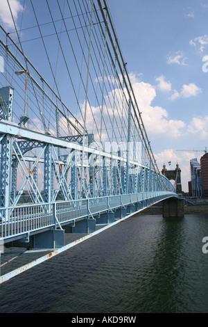 The Roebling suspension Bridge, aka the Blue Bridge, spanning the Ohio River from downtown Cincinnati, Ohio to Newport, - Stock Photo