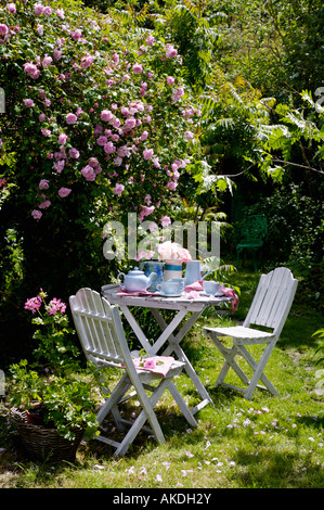 Wonderful White Garden Furniture And Pink Roses Stock Photo Royalty Free  With Inspiring  White Chairs And Table Set For Tea Below Pink Climbing Roses In Summer  Garden  Stock With Divine Asfordby Garden Centre Also Miniclip Blooming Gardens Full Screen In Addition Garden Circles And Manchester Piccadilly Gardens Postcode As Well As Nardi Garden Furniture Additionally Gastro Pub Covent Garden From Alamycom With   Inspiring White Garden Furniture And Pink Roses Stock Photo Royalty Free  With Divine  White Chairs And Table Set For Tea Below Pink Climbing Roses In Summer  Garden  Stock And Wonderful Asfordby Garden Centre Also Miniclip Blooming Gardens Full Screen In Addition Garden Circles From Alamycom