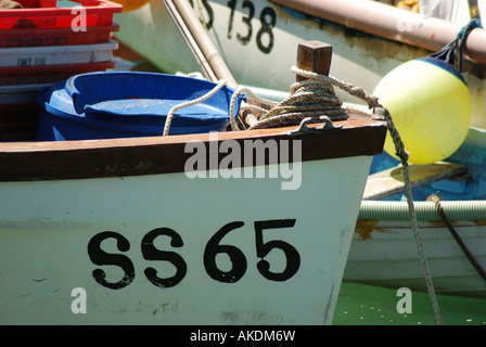 Bow of boats moored in harbour at St Ives on a summer's sunny afternoon - Stock Photo