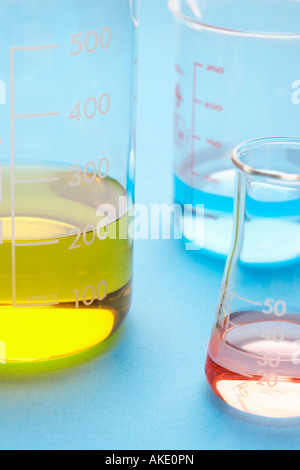Coloured liquids in beakers, close-up - Stock Photo