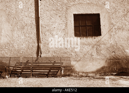Old green benches in the square of Calenzano Valtrebbia Italy - Stock Photo