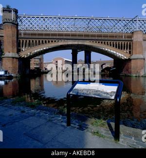 Cast iron arch railway bridge over the Duke of Bridgewater's Canal, Castlefield Urban Heritage Park, Manchester, - Stock Photo