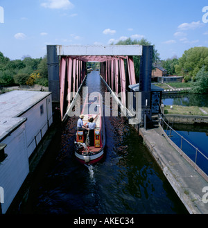 Canal narrow boat crossing the Barton Swing Aqueduct, Trafford Park, Barton-upon-Irwell, Greater Manchester, England, - Stock Photo