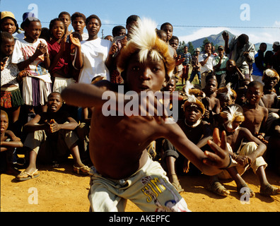 A boy performing the traditional zulu dance in South Africa - Stock Photo