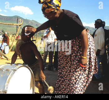 A young boy playing drums and Zulu dancing in South Africa - Stock Photo