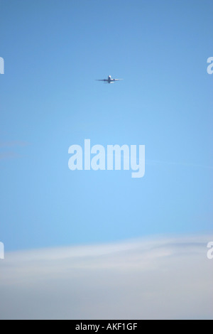 Airplane on the distance - Stock Photo
