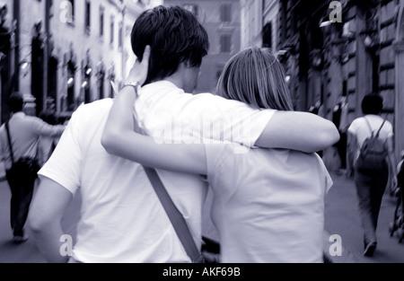 Rome, Couple Walking Along Street - Stock Photo