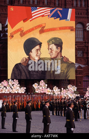 Russian Soldiers in Red Square under a poster celebrating the end of World War II, Moscow, Russia - Stock Photo
