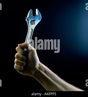 wrench in hand editorial use only - Stock Photo