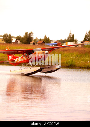 Float plane taking off from the Lake Hood Seaplane Base in Anchorage Alaska. - Stock Photo