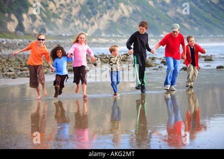 Children Running on Beach Mussel Shoals Carpenteria Santa Barbara County California United States (MR) - Stock Photo