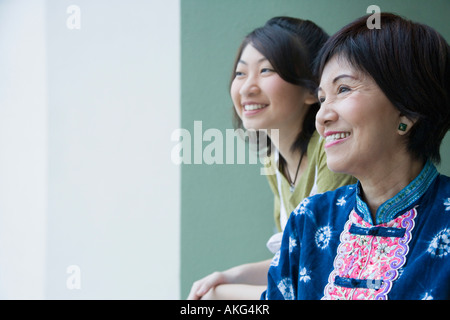 Close-up of a senior woman smiling with her granddaughter