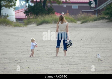 Mother and toddler at the beach on the Great Lakes Michigan Family - Stock Photo