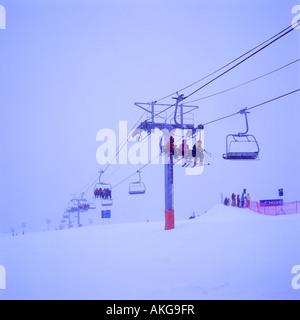 Ski Lift approaching The Roundhouse on Whistler Mountain in the Ski Resort of Whistler British Columbia Canada - Stock Photo