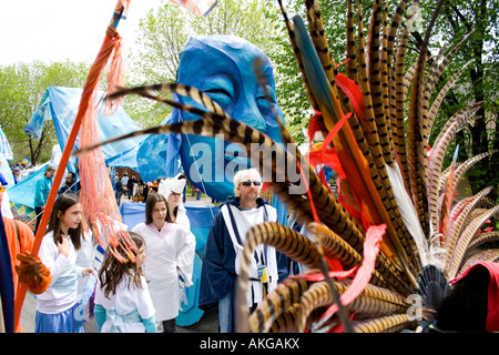 Blue moon puppet from Tree of Life Ceremony famed by Aztec head feathers. MayDay Parade and Festival. Minneapolis - Stock Photo