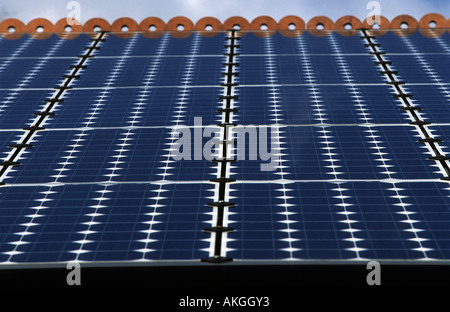 Photovoltaic cells (solar panels) on the roof of a house to produce electricity. - Stock Photo