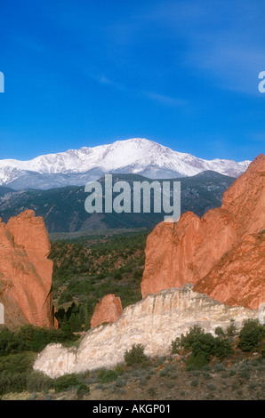 Garden of the Gods rock formations with snow-capped Pikes Peak behind Colorado Springs, Colorado - Stock Photo