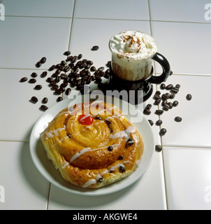 cup of capuccino and danish pastry editorial use only - Stock Photo