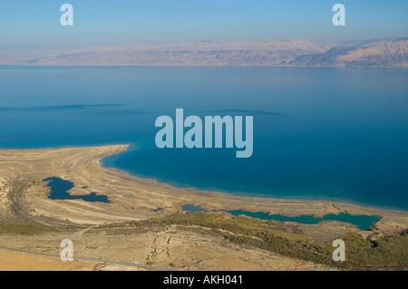 Israel Dead Sea elevated view clearly showing sink holes and successive marks due to receding sea  - Stock Photo