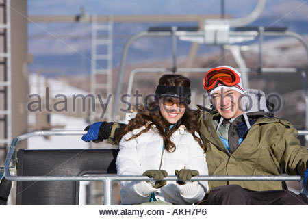 Couple on a chair lift - Stock Photo