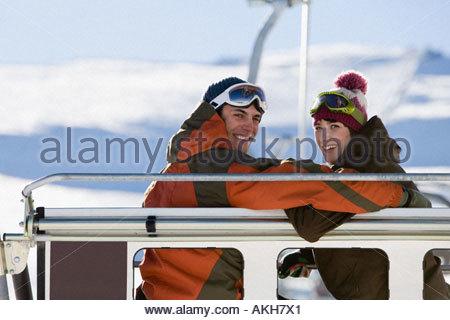 Couple on a ski lift - Stock Photo