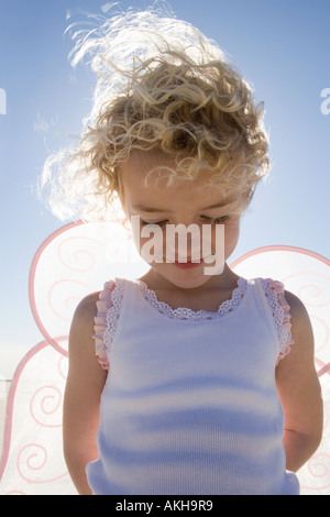 Smiling girl with wings, - Stock Photo