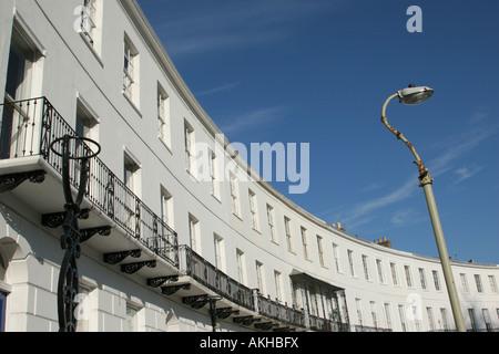 Terraced buildings in Royal Crescent, Cheltenham, Cotswolds, U.K. - Stock Photo