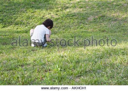 Boy alone in a field - Stock Photo