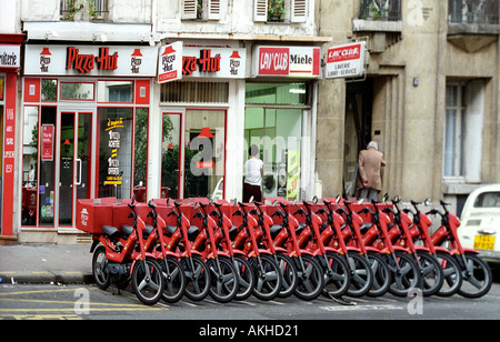 Pizza delivery bikes lined up outside Pizza Hut in Paris France - Stock Photo